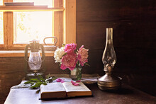 Still Life Of Vintage Items And A Bouquet Of Peonies On A Table By The Window In An Old Village House.