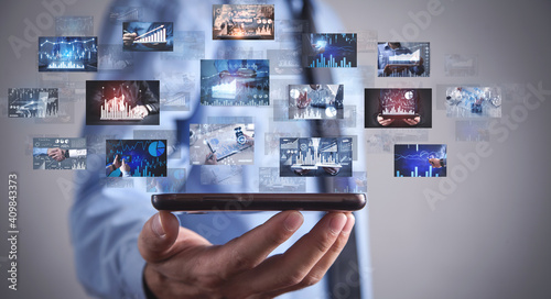 Obraz Man holding a digital pictures of business graphs. Business. Technology - fototapety do salonu