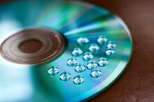 Macro Shot Of Water Drops On A Blue Compact Disc