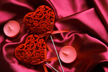 Hearts Decoration Home Decor On A Silk Background With Romantic Candles. Valentines Day Background.