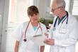Leinwandbild Motiv Two doctors discussing about medical report
