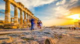 People in motion blur walking around the ruins of Parthenon temple in Athens, Greece