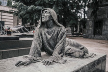 Stone Statue Of Woman Lying In Cemetery