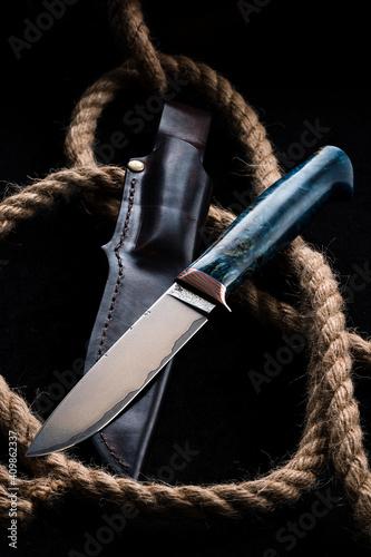 Billede på lærred Hunter combat hand made knife and hemp rope