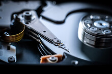 Closeup Of Head Of Hard Disk Drive On Dark Background