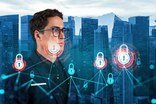 A Young Handsome Eastern Cybersecurity Developer Thinking About New Concepts At Security Compliance Division To Protect Clients Confidential Information. IT Lock Icons Over Singapore Background.
