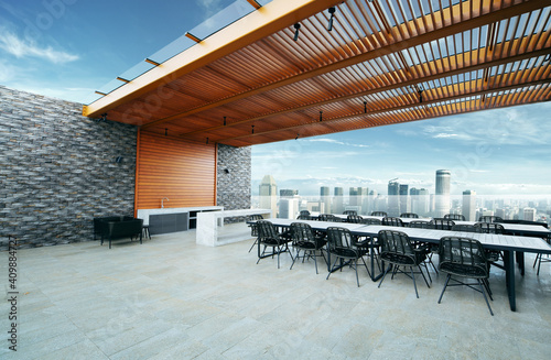 Fototapeta Modern sky lounge  and kitchen on roof top and stunning cityscape view