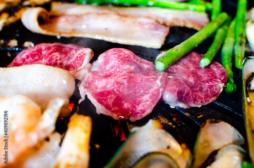Canvas Print Grilled wagyu beef with beautiful fat on tradition charcoal grill stove