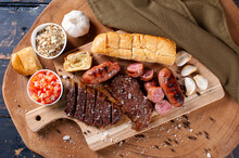 .Typical Brazilian Barbecue, With Garlic Bread, Picanha, Sausage, Vinaigrette And Farofa