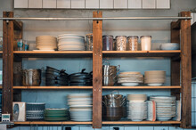 Kitchenware With Dishware On Kitchen Wooden Shelving