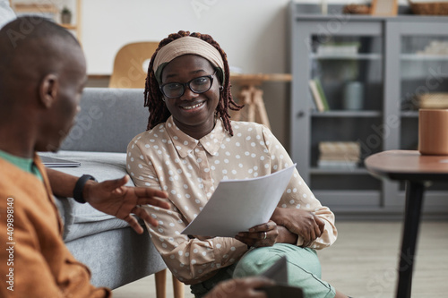 Fotografie, Obraz Portrait of modern African-American couple working from home together, focus on