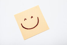 Happy Smiley Face Drawn On Yellow Post-it Notes