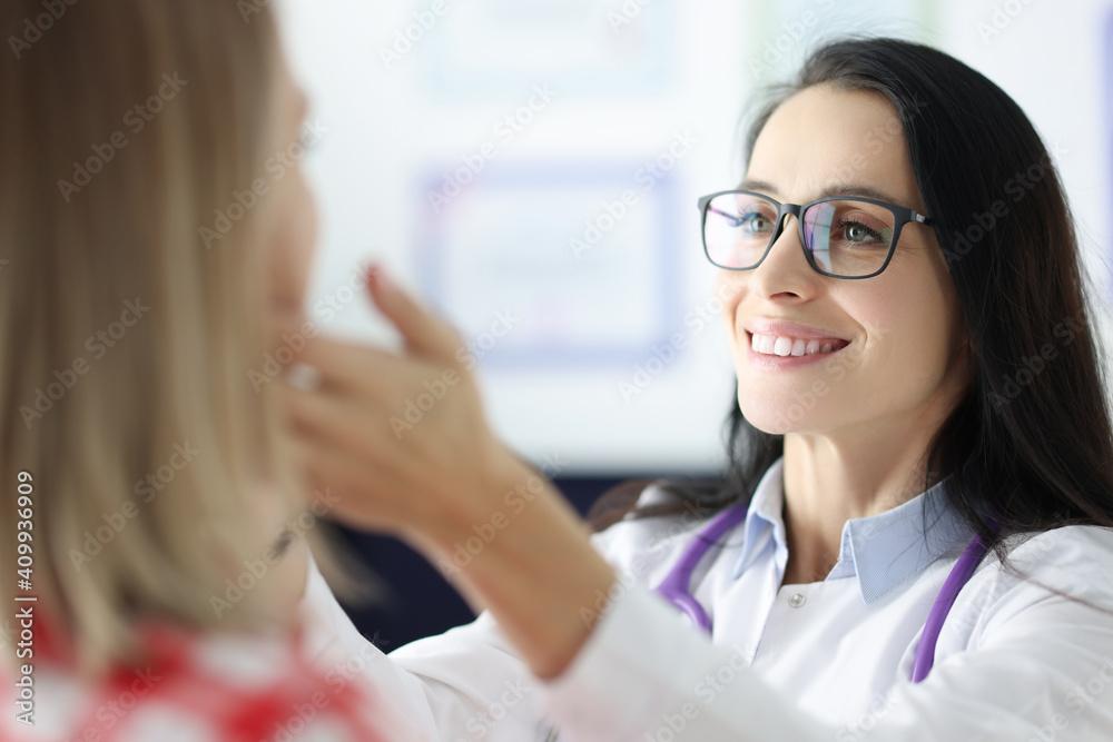 Fototapeta Female doctor palpating patients submandibular lymph nodes