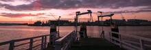 Panoramic View To The Shipyard With Cranes In Kiel At Dawn, Banner