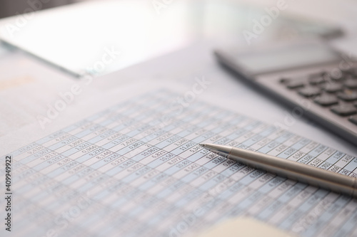 Obraz Ballpoint pen and calculator lying on documents with numbers closeup - fototapety do salonu
