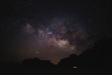 From Below Of Glowing Stars Of Milky Way At Night Sky In Wadi Rum