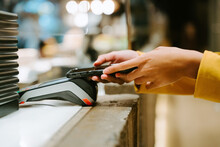 Unrecognizable Crop Female Buyer Using Smartphone For Payment On POS Terminal In City