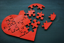 A Broken Heart Made From Puzzle Pieces As A Symbol Of Relationship Problems.