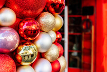 Shop Facade With Red Door Decorated With Christmas Decorative Sparkling Baubles
