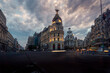 Low angle of famous Metropolis Building under cloudy sky in evening in Madrid