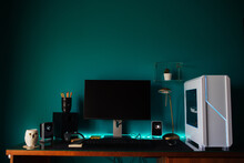 Modern Stylish Black Gaming Computer With Keyboard And Speakers Placed On Table Near Joystick Lamp And Stationery