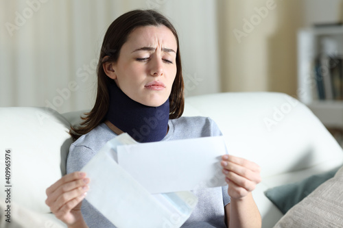 Sad disabled woman reading bad news on letter Poster Mural XXL