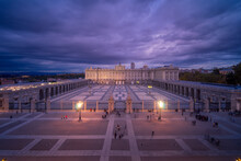 Magnificent Scenery Of Royal Palace Of Madrid And Square Illuminated By Street Lamps In Evening