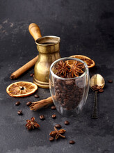 Coffee  Beans With Dry Orange, Anise And Cinnamon On Black Background.