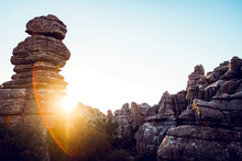 Low Angle Of Unusual Rocky Formations Located In El Torcal De Antequera Nature Reserve Under Cloudless Blue Sky On Sunny Day