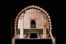 Ornamental Carved Arched Windows Of Ancient Ben Youssef Madrasa Historic Islamic College Located In Marrakesh