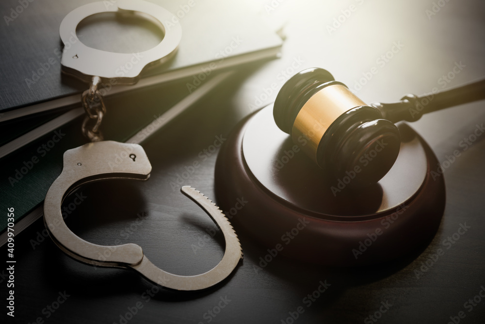 Fototapeta Crime and violence concept with handcuffs