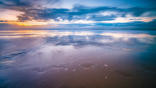 The Sunset With The Reflection Of Clouds In Low Tide Water In Waddenzee, Texel, The Netherlands