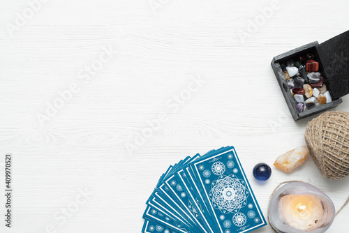 Tarot cards deck on the white table background.