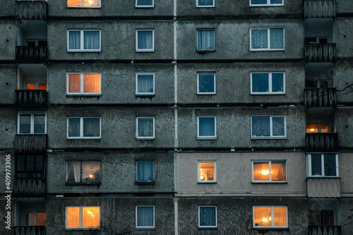 Fototapeta Beautiful view of a facade of a residential building with illuminated windows