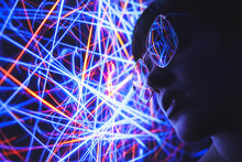 From Below Of Female In Trendy Sunglasses Illuminated By Red And Blue Abstract Neon Lights In Darkness