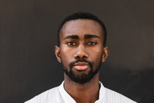 Confident African American Male Wearing White T Shirt Standing On Street While Looking At Camera