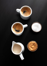 Cups Of Coffee Served On A Tray On Dark Background