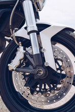 Closeup Of Front Wheel With Disk Brake System And Tire Of Modern Motorbike