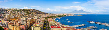 Naples City And Port With Mount Vesuvius On The Horizon Seen From The Hills Of Posilipo. Seaside Landscape Of The City Harbor And Gulf On The Tyrrhenian Sea