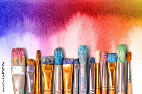 A row of artist paint brushes on desk