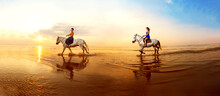 Couple In Love, Which Is Galloping On A Horse Of The Sea At Sunset