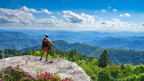 Obraz Man standing on top of the mountain relaxing and  enjoying beautiful summer mountain landscape. Near Asheville, Blue Ridge Mountains, North carolina, USA. - fototapety do salonu