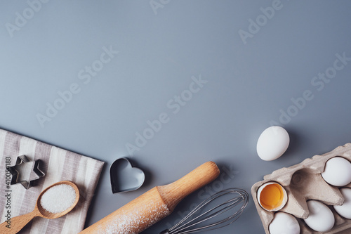 Foto Flat Lay composition, ingredients for baking cookies on a gray background, copy space