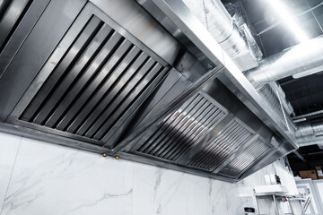 New clean stainless steel hood in professional kitchen