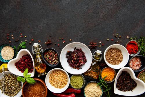 Fotografía Various spices in a bowls on a black