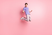 Full Length Body Size Photo Of Brunet Jumping High Gesturing Like Winner Cheerful Isolated On Pastel Pink Color Background