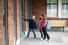 Children Opening School Door