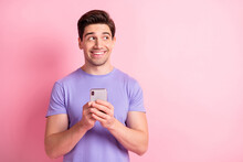 Portrait Of Nice Cheerful Creative Guy Using Device Looking Aside Copy Space Isolated Over Pink Pastel Color Background