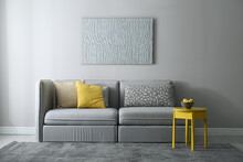 Stylish Living Room With Sofa. Interior Design In Grey And Yellow Colors