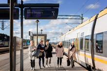 Passengers At Train Platform